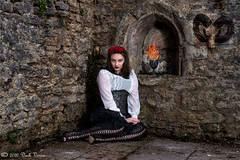 Female model, fire, chalice, goat's head, church ruin