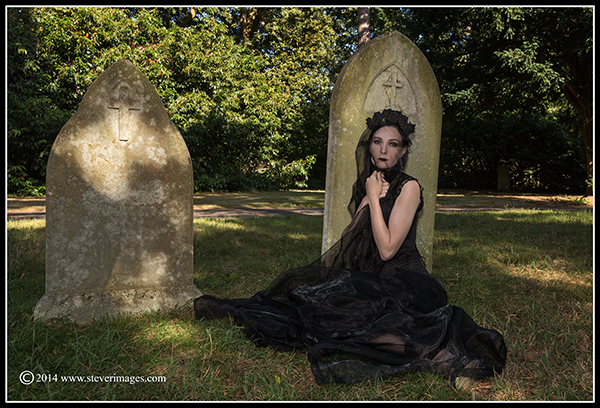 Gravestones, graveyard, woman in black, two gravestones, photo