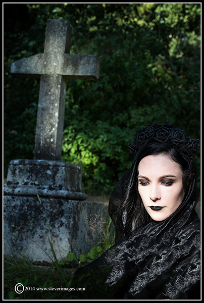 Woman in black, gravestone, photo