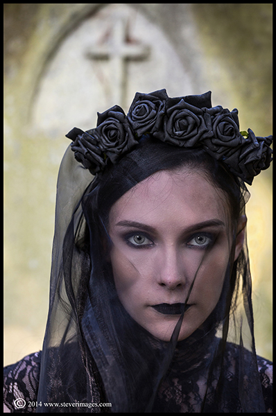 graveside vigil, model in black veil, graveyard. Victoria park, Southampton, photo