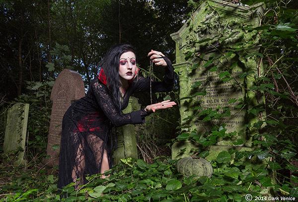 grayeyard ritual, model in black dress, gravestone, rosary, Tower Hamlets cemetery, photo