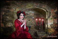 Netley Abbey, woman in Red, red candles,