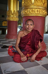 Monk sitting down, temple, Yangon