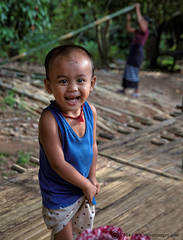 Happy face, child from Burma, road to golden rock
