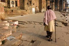 Indian Man walking with stick, Varanasi, India