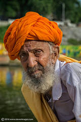 Portrait Indian man in orange turban