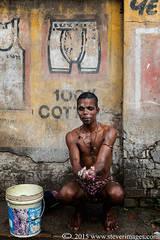 man washing, backstreets of Varanasi, India