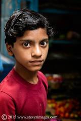 Portrait,Boy, red, market at Varanasi India