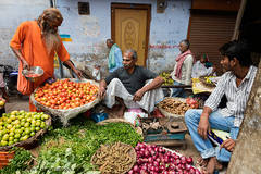 Hindu man, buying fruit, Market Varanasi India
