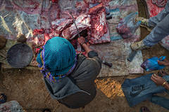 Nepal, outdoor, cutting meat