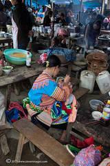 Mother feeding child, Bac Ha market, North Vietnam