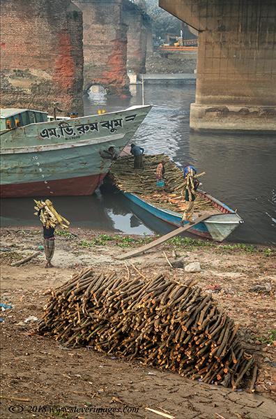 View of man loading wood at shipyard , Bangladesh