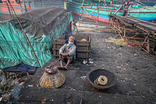 Boatyard , man resting, Bangladesh