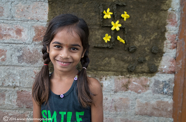 Portrait, Indian child, smile, yellow flowers