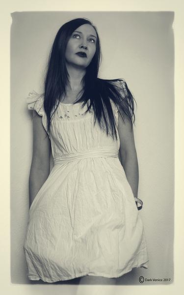 Indoor portrait, female model indoors, white dress.