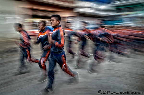 Men running in tracksuits, Nepal