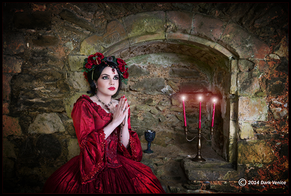 Netley Abbey, woman in Red, red candles, , photo