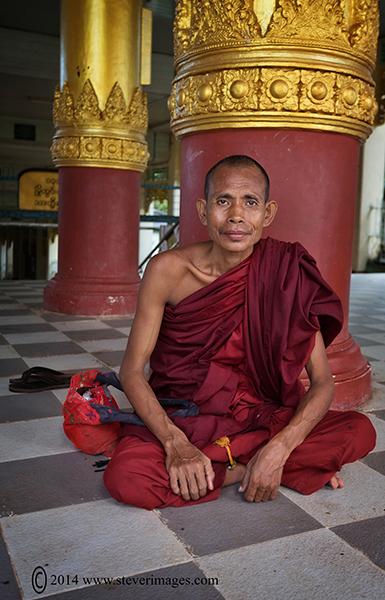 Monk sitting down, temple, Yangon, photo