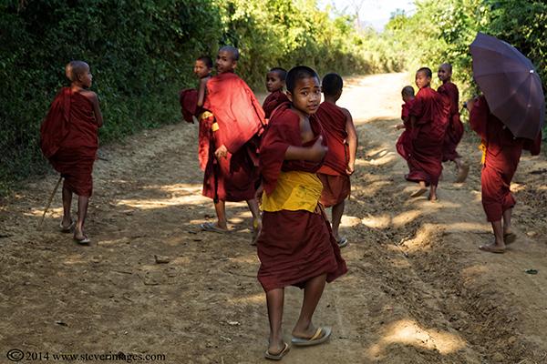 Monks walking, turning back, photo