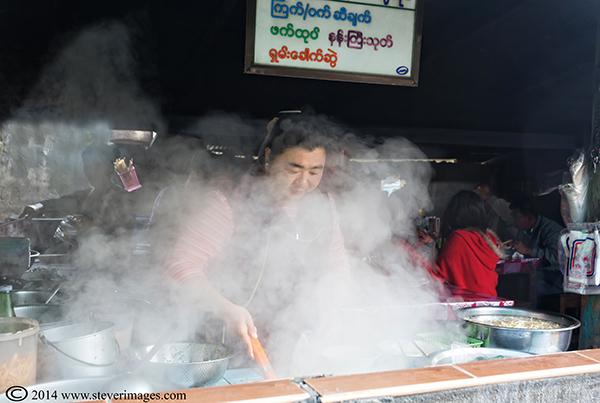 Hot smoke, cooking, market food Burma, photo