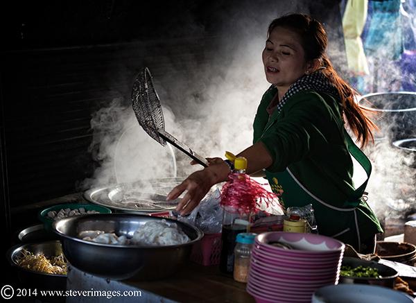 lady cooking, smoke, market Burma, photo