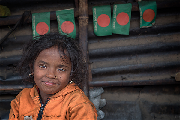 Portrait of young girl, Bangladesh flags, photo