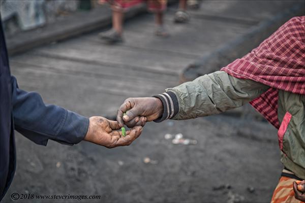 coin changing hands, Bangladesh, photo