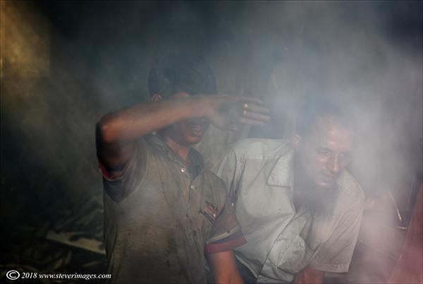 Men at work, smoke, Bangladesh factory, photo
