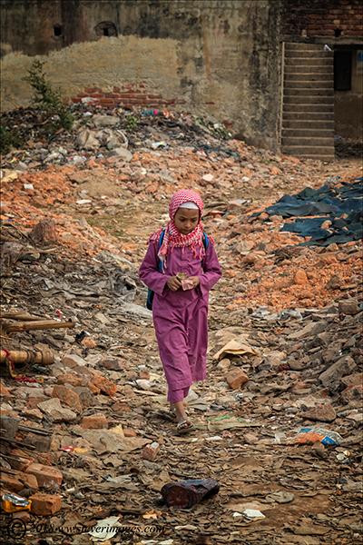 Girl walking home, ruins, Girl walking home through rubble in Bangladesh