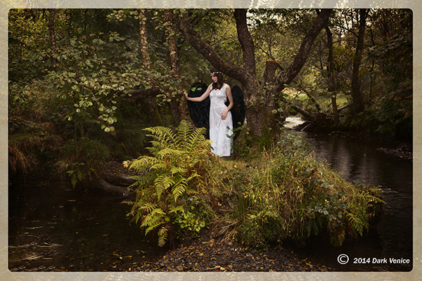 Woman in white, Black wings, by riverbank, stream, forest, photo
