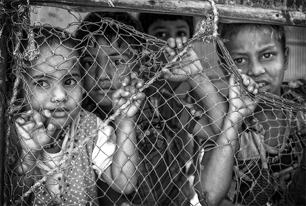 Black and white , children, behind wire, photo
