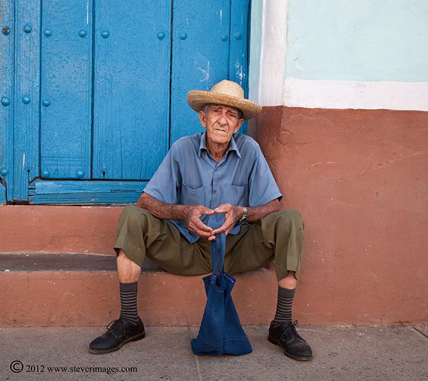 Person sitting, Trinidad, Cuba, Image of person sitting on ground in Trinidad, Cuba.