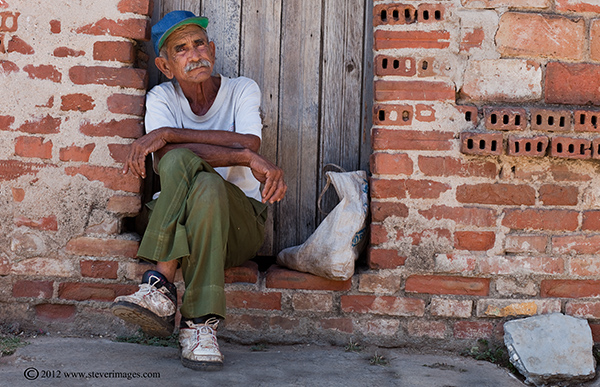 person at rest, Trinidad, Cuba, Image of person sitting on ground in Trinidad, Cuba.