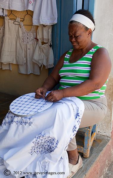 Sowing, Trinidad, Cuba, Image of lady sowing in Trinidad, Cuba.