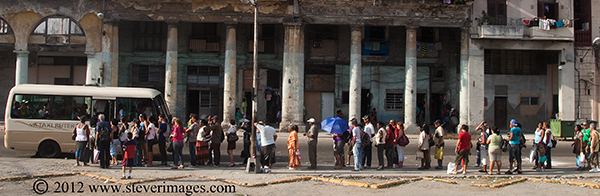 People, queue for the bus, Havana, Cuba, Image of people waiting to get on a local bus in Havana