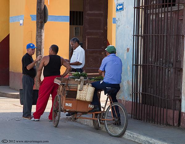 Strret corner conversation, Trinidad, Cuba, Images of men having a street corner conversation in trinidad
