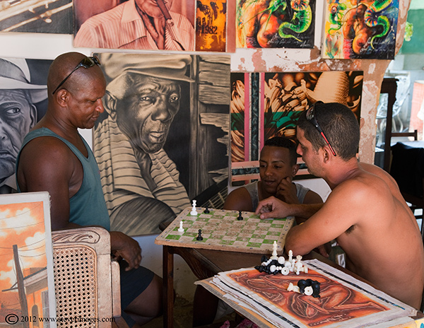 Playing Ches, Trinidad, Cuba, Image of 2 people playing chess indoors in Trinidad