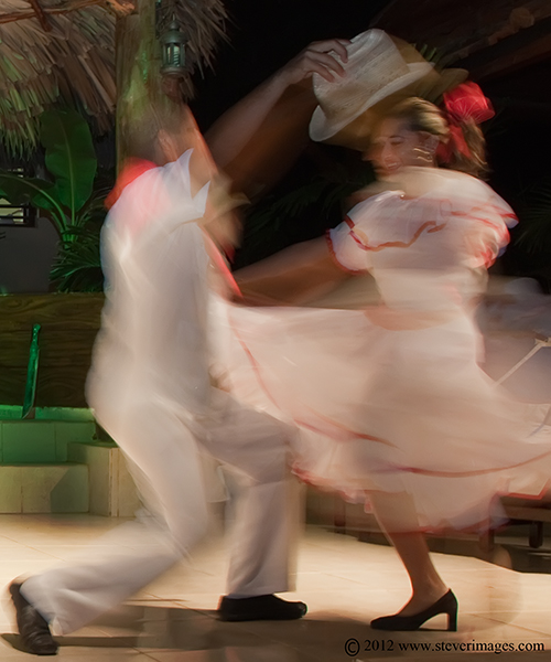 I wanted to capture something of the movement and drama of dance in Cuba, so i focused on 2 dancers and used a slow shutter speed...