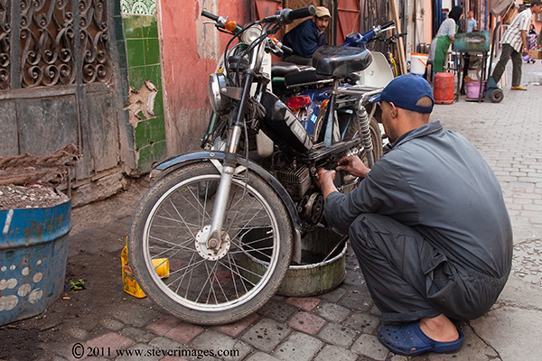 motor bicycle repair, Backstreets Marrakech, photo