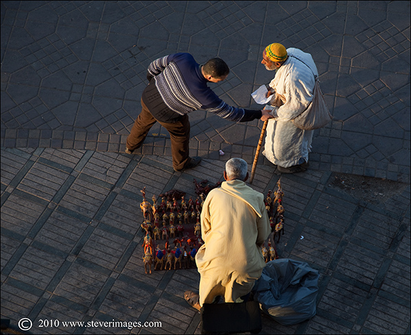 An overhead view of a brief interaction in Djemma-el-Fna square, Marrakech