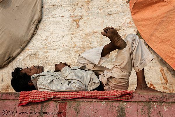 Candid photo of Indian man asleep in Varanasi, India, photo