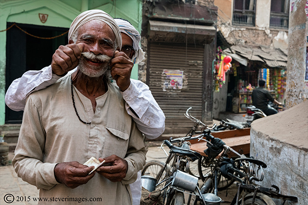 two Indian men having a laugh. Varanasi India, photo