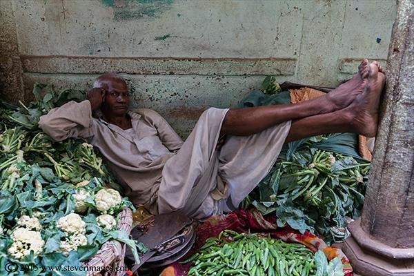 Indian male resting, Varanasi, India, photo