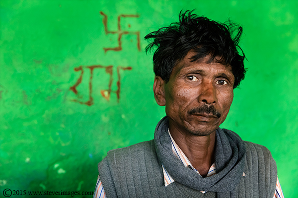 Indian male portrait, swastika, Varanasi, India, photo
