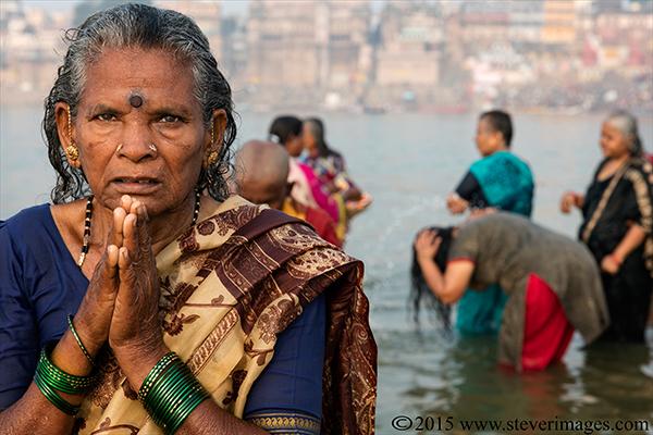 Indian woman praying, river Ganges, Varanasi, India , photo