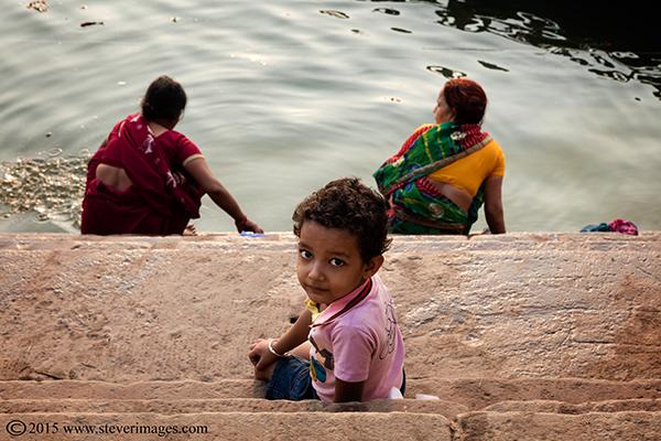 Boy, Ganges, women washing in Ganges, Varanasi, India, photo