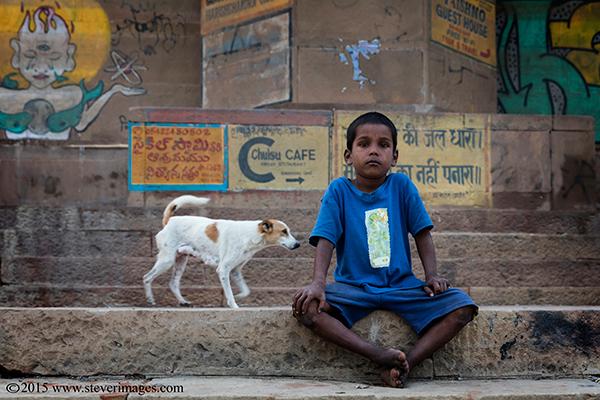Boy, dog, Varanasi, India, photo