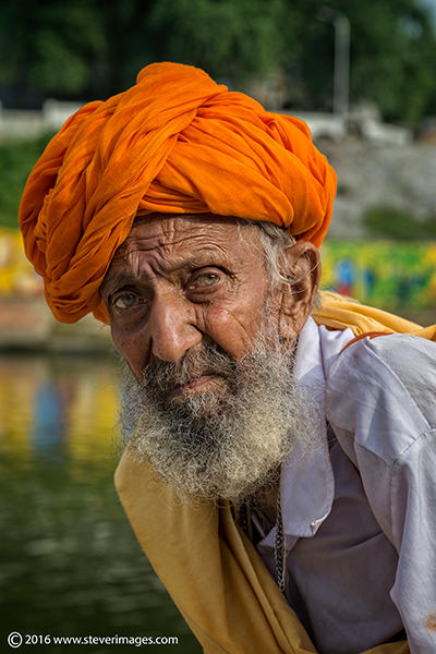 Portrait Indian man in orange turban, photo