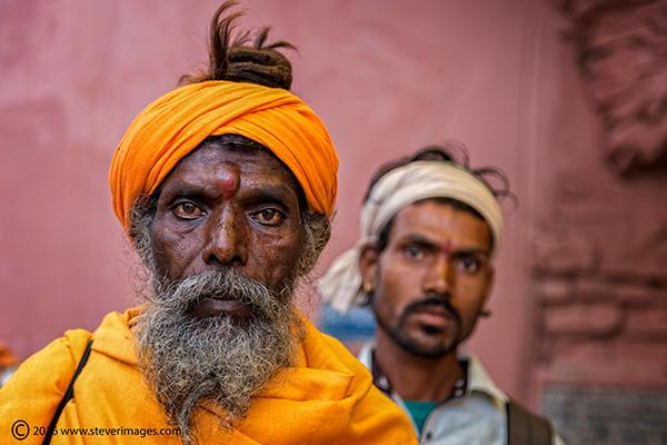 Hindu teacher, portrait, Indian man in orange, photo
