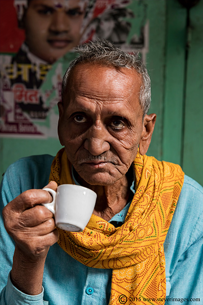man , tea, Varanasi back streets, India, photo